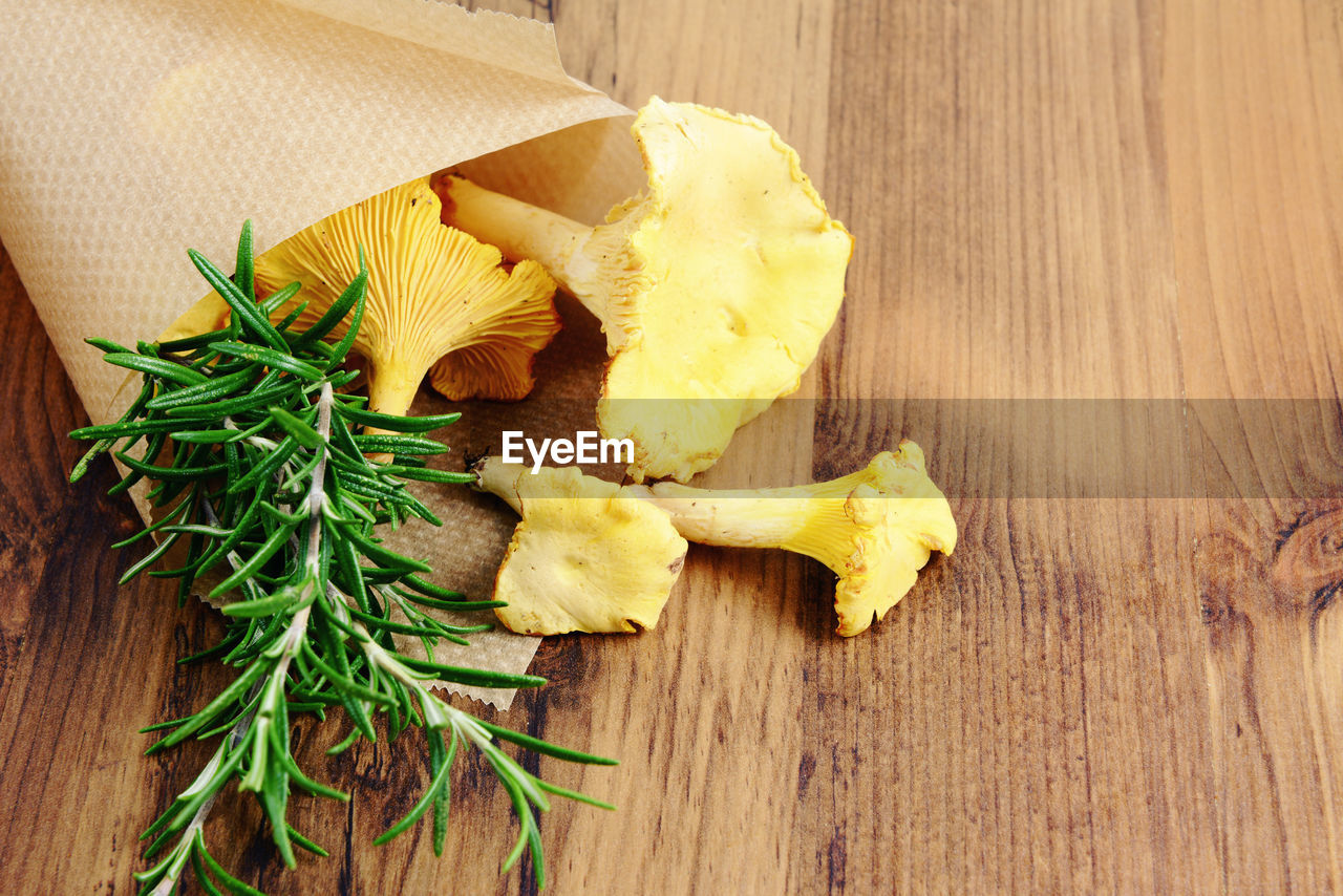 Close-Up Of Golden Chanterelle On Wooden Table