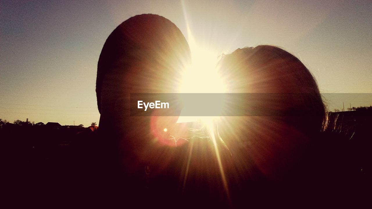 lens flare, sunbeam, sun, silhouette, sunlight, sunset, clear sky, sky, outdoors, nature, day, no people, close-up