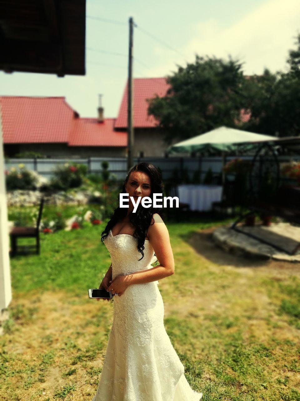 Portrait of bride standing on field