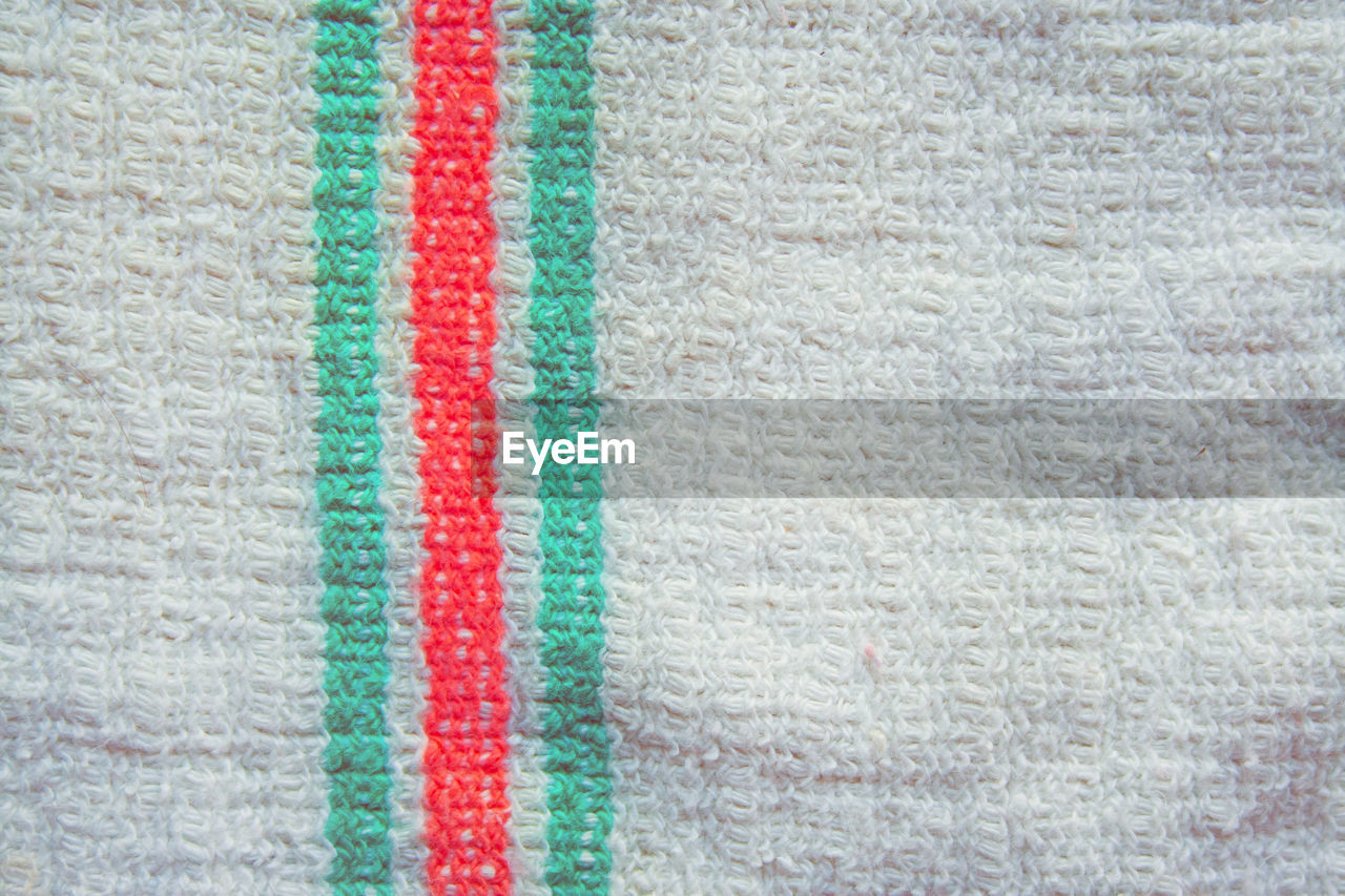 textile, close-up, full frame, backgrounds, no people, pattern, textured, wool, multi colored, indoors, red, towel, material, clothing, extreme close-up, creativity, softness, day, green color, white color, turquoise colored, warm clothing, textured effect