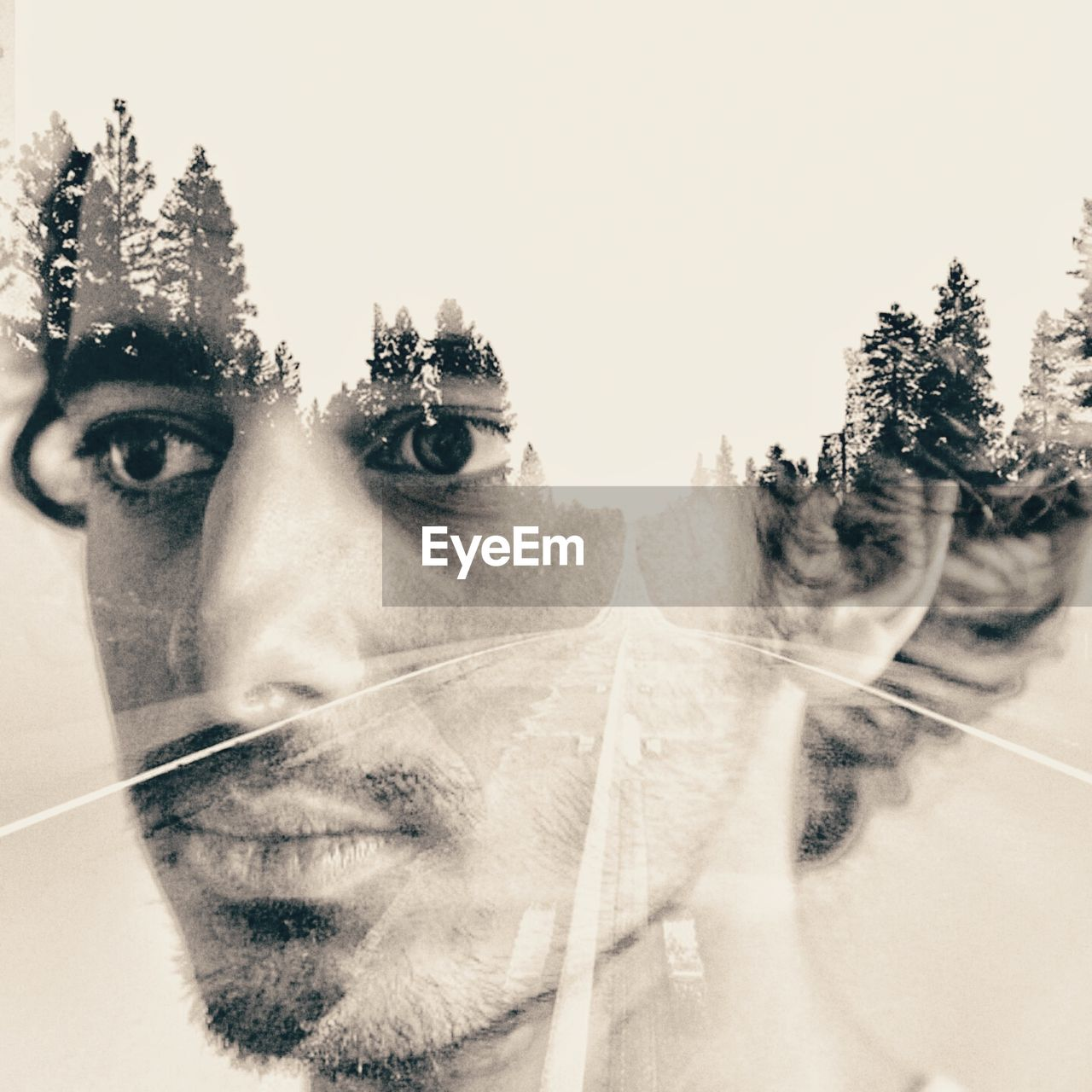 Double Exposure Of Thoughtful Man And Trees