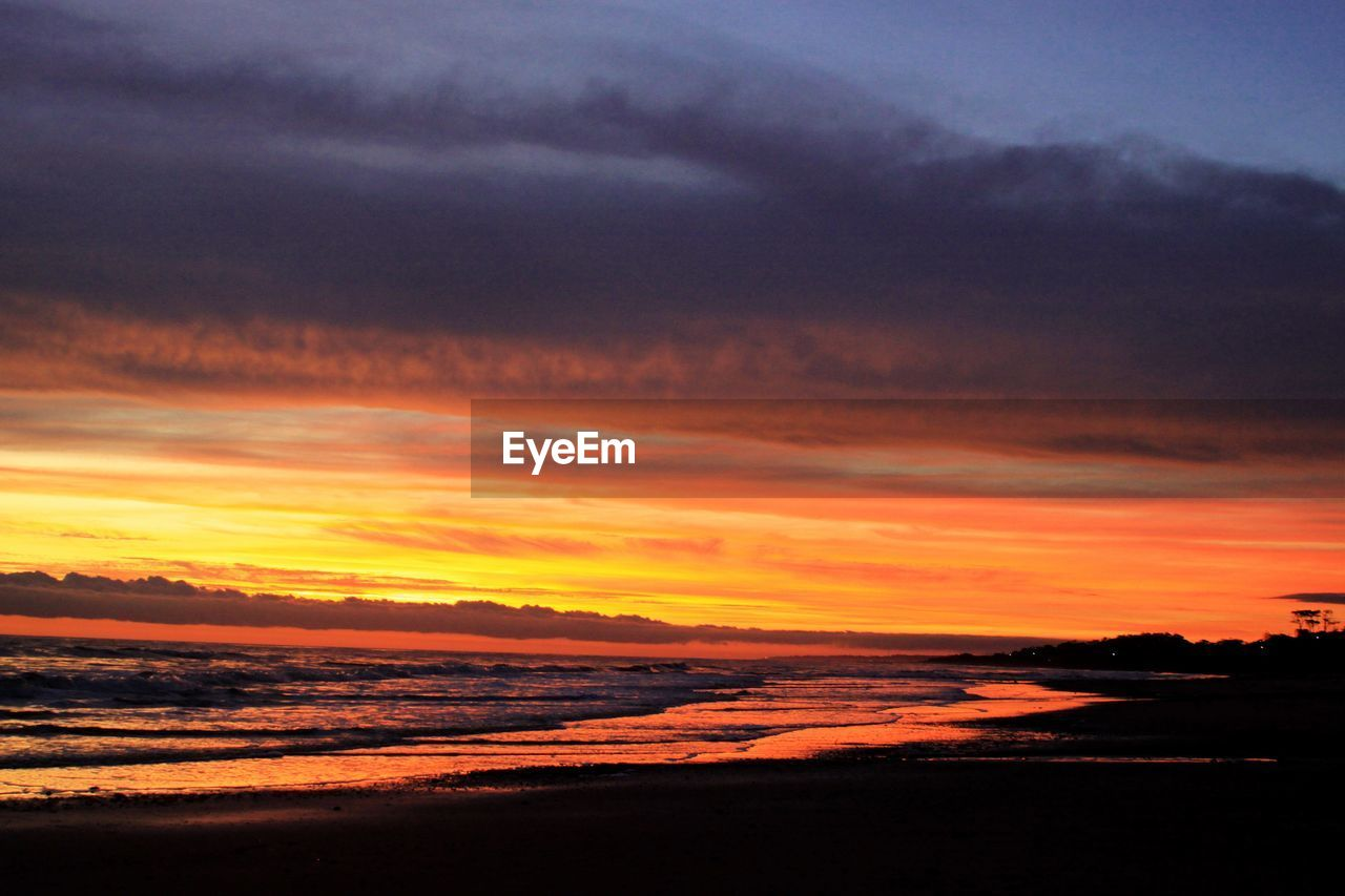 sunset, sky, beauty in nature, cloud - sky, scenics - nature, tranquility, orange color, tranquil scene, idyllic, water, nature, sea, no people, dramatic sky, horizon, silhouette, beach, outdoors, land, horizon over water, romantic sky