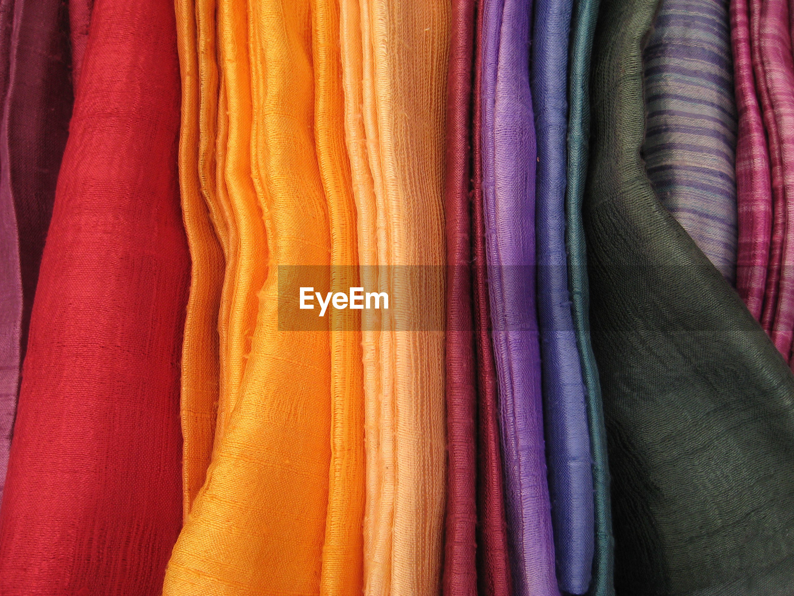 Full frame shot of colorful fabrics for sale at store