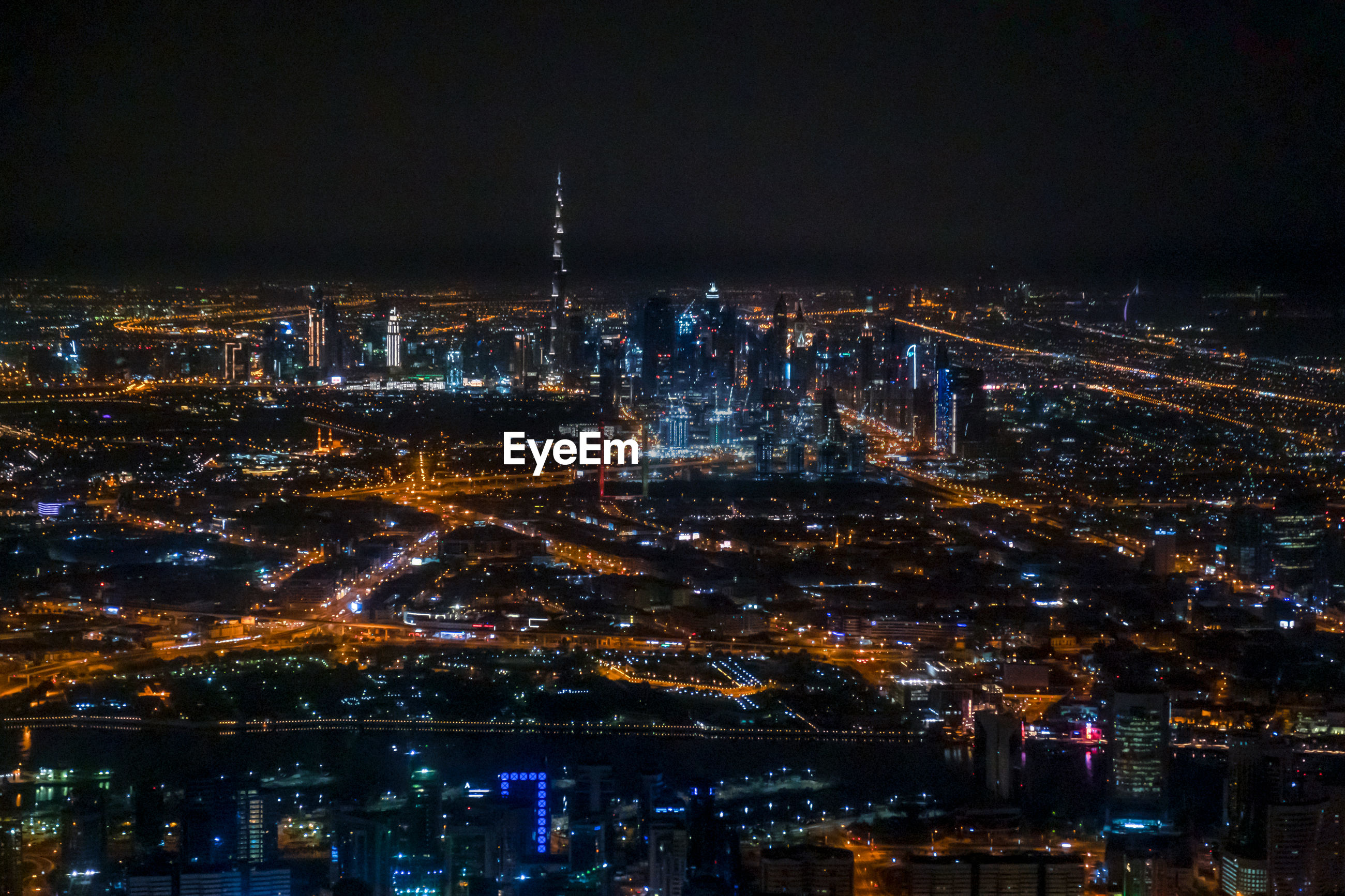 High angle view of city of dubai lit up at night