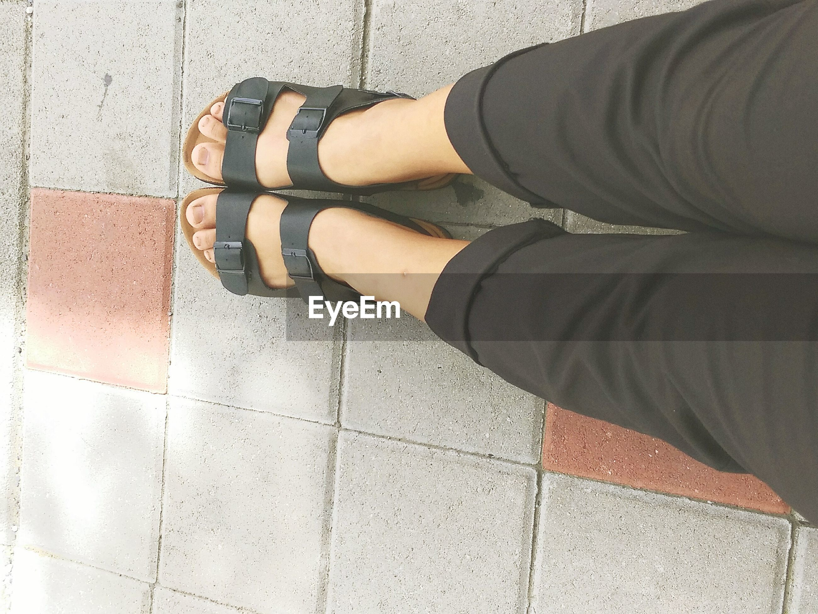 low section, person, shoe, men, standing, lifestyles, jeans, pattern, leisure activity, high angle view, human foot, cobblestone, unrecognizable person, part of, footwear, paving stone