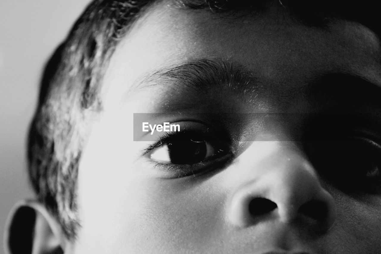 childhood, close-up, innocence, real people, one person, indoors, human face, headshot, portrait, looking at camera, human eye, day