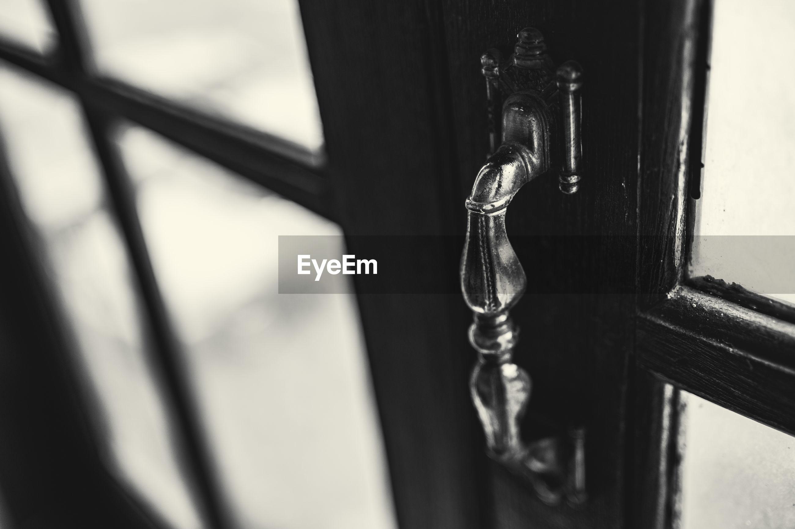 CLOSE-UP OF METAL DOOR WITH HANDLE