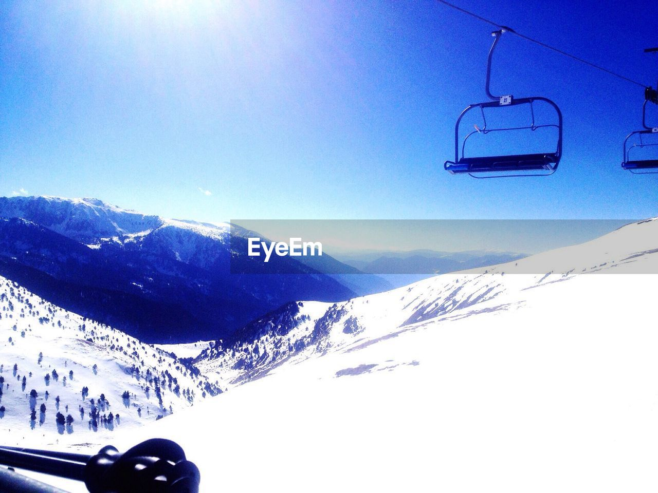 snow, cold temperature, winter, mountain, mountain range, scenics - nature, sky, mode of transportation, transportation, snowcapped mountain, beauty in nature, nature, cable car, sunlight, day, ski lift, environment, overhead cable car, land vehicle, no people, outdoors, bright