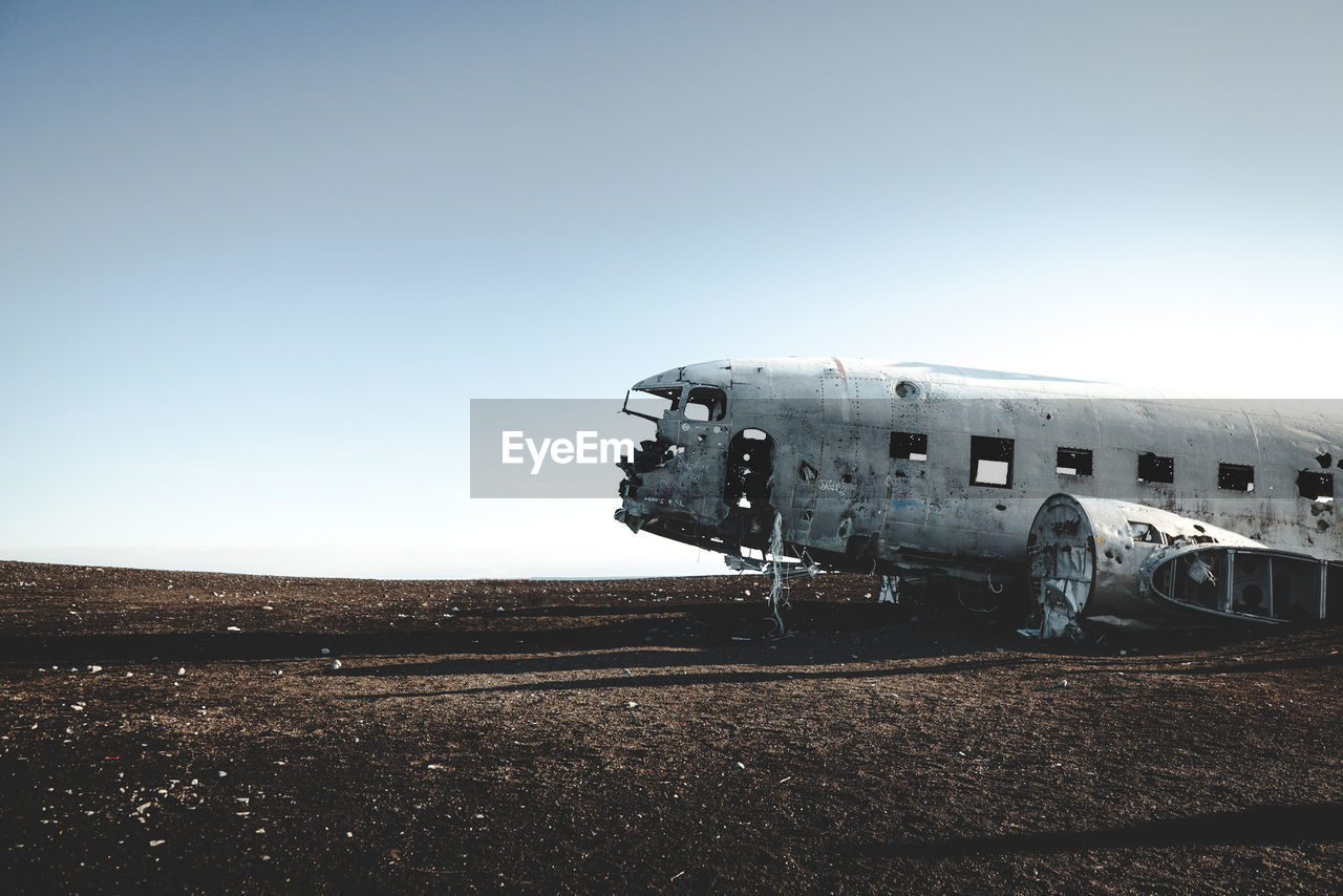 Abandoned Airplane On Field Against Clear Sky