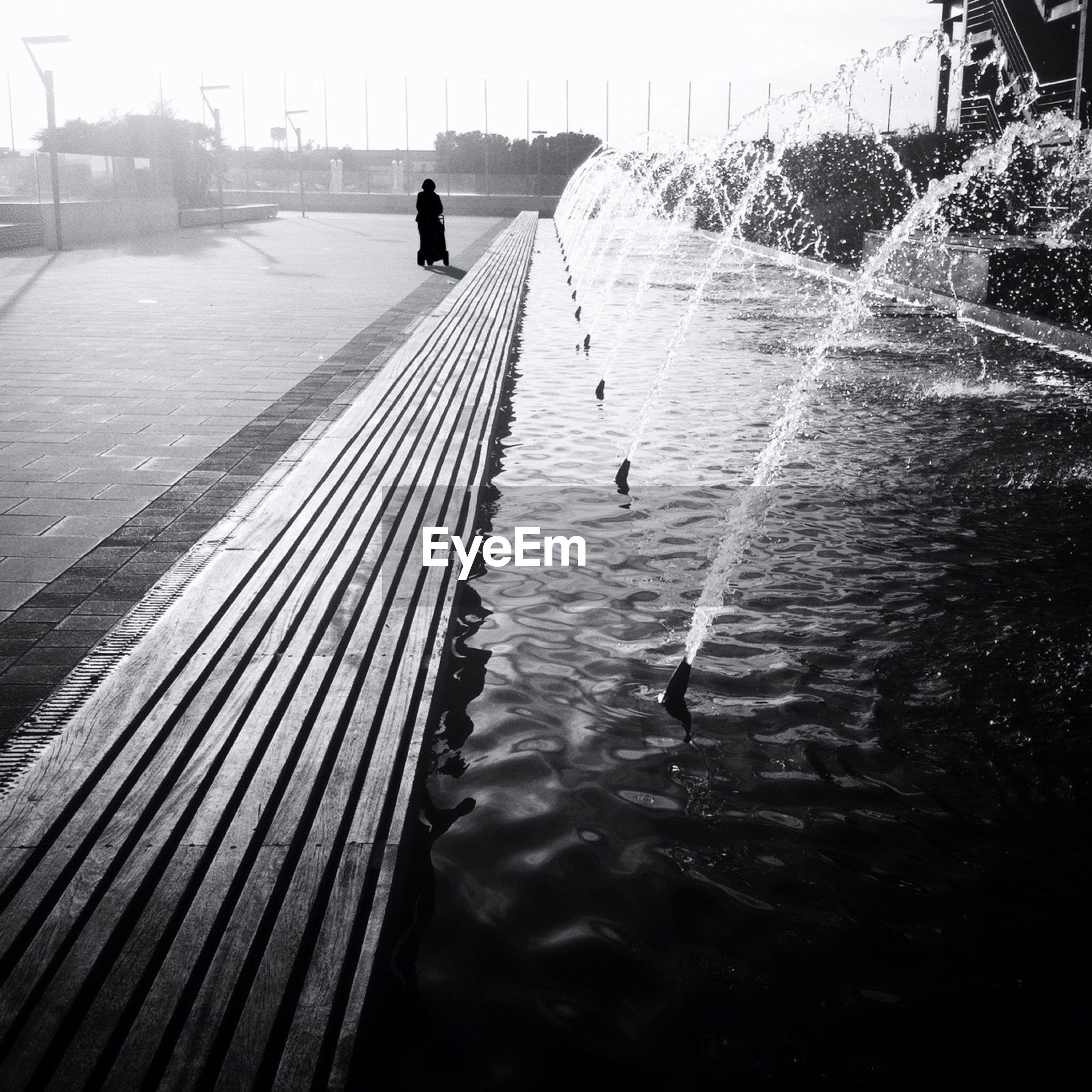 Sidewalk by fountain