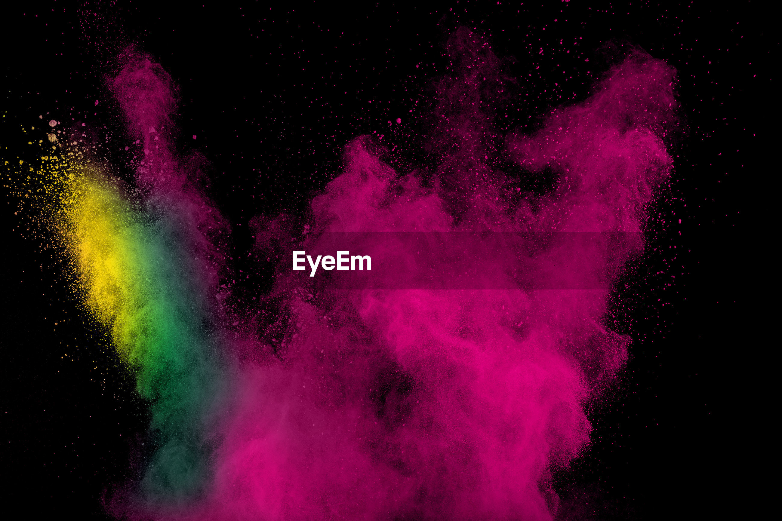 Close-up of colors exploding on black background
