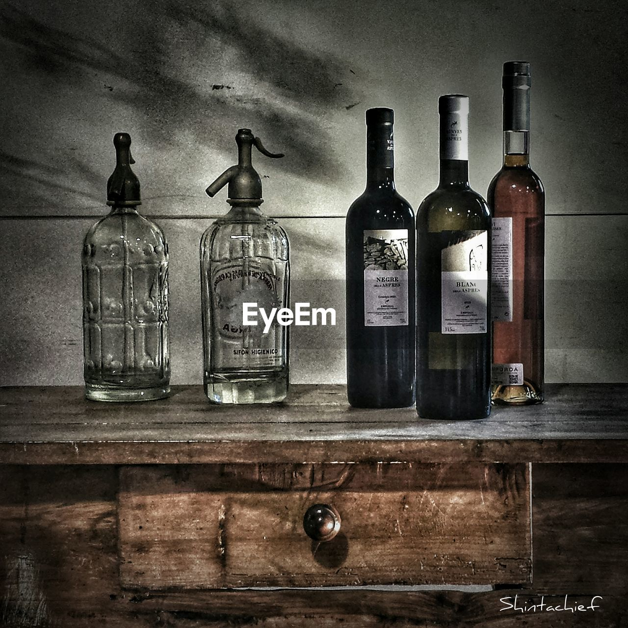 bottle, indoors, shelf, wine bottle, old-fashioned, wood - material, no people, arrangement, wine, alcohol, laboratory, day
