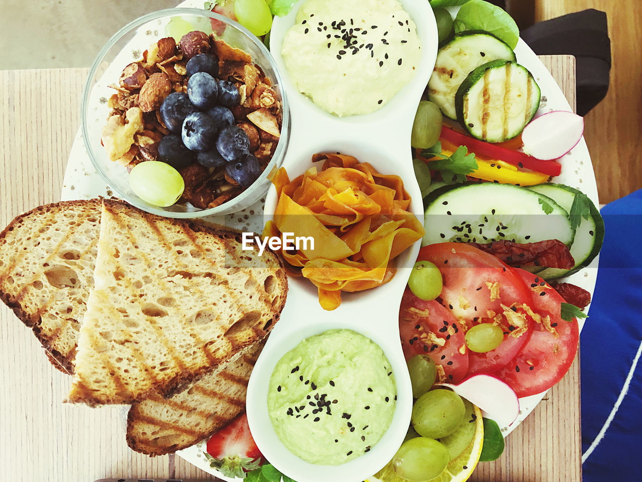 food, food and drink, freshness, healthy eating, ready-to-eat, wellbeing, fruit, meal, bread, bowl, vegetable, still life, plate, indoors, high angle view, table, no people, directly above, serving size, salad, breakfast, dip, snack, vegetarian food