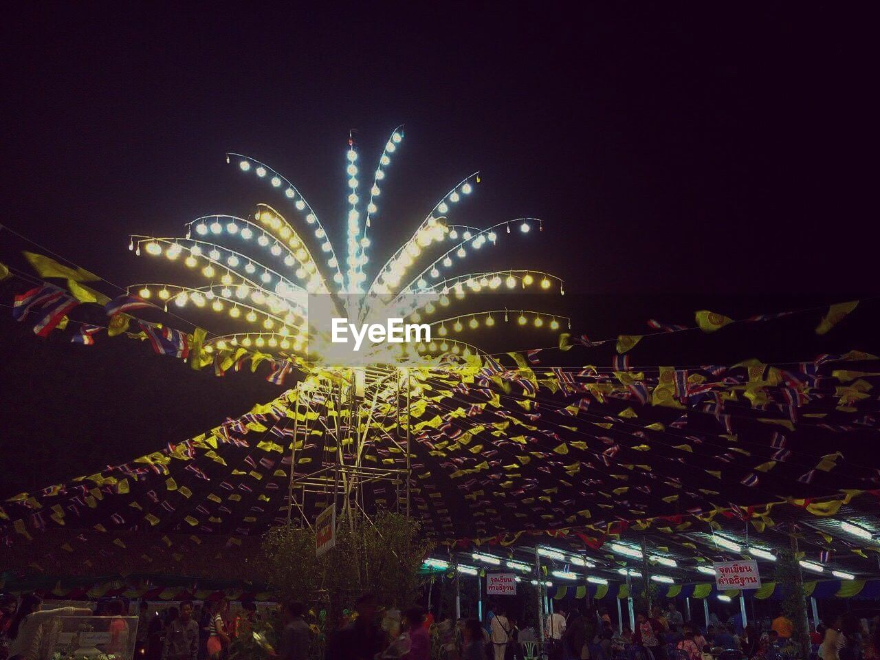 night, celebration, illuminated, low angle view, firework display, long exposure, outdoors, firework - man made object, event, arts culture and entertainment, sky, no people, clear sky, city