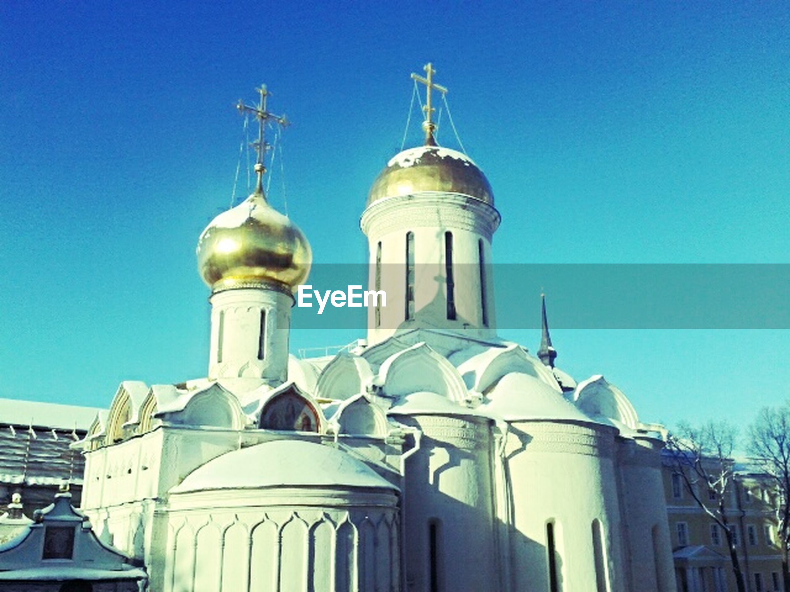 place of worship, religion, building exterior, architecture, church, built structure, spirituality, dome, blue, low angle view, clear sky, mosque, cross, high section, cathedral, sky, day