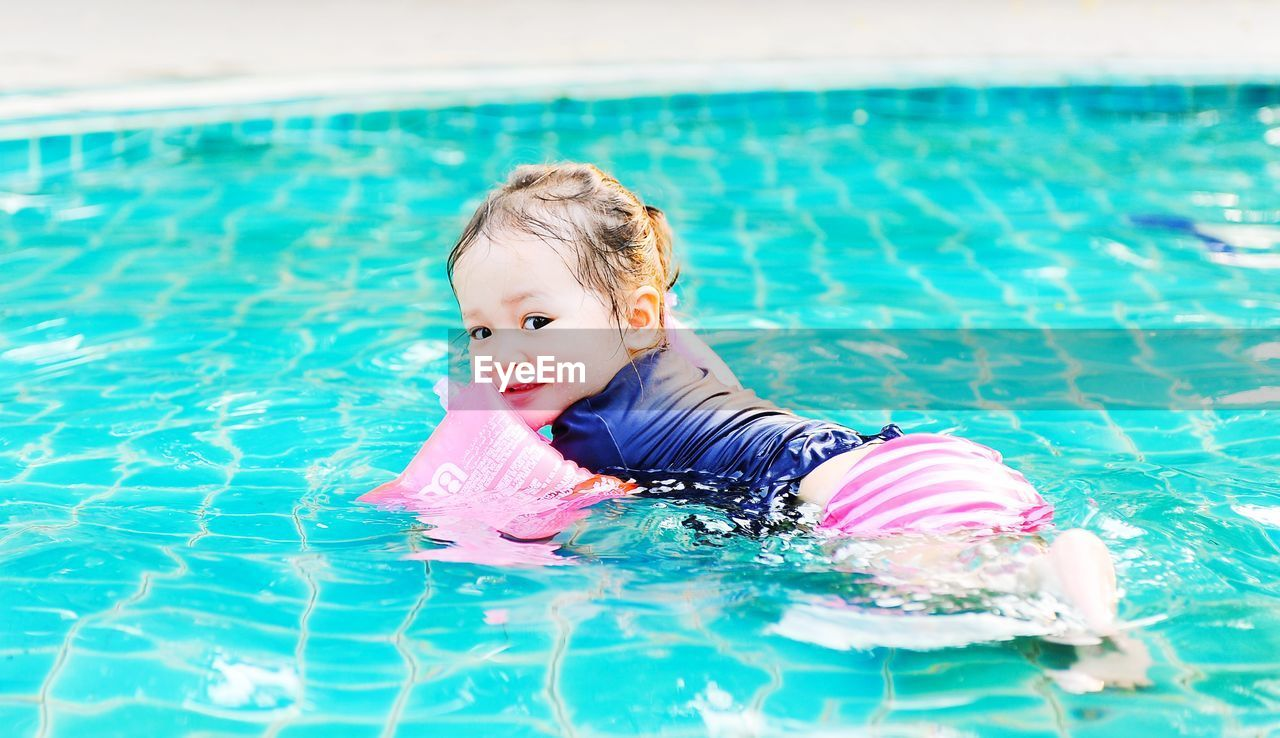 swimming pool, pool, water, childhood, child, one person, real people, baby, leisure activity, swimming, waterfront, young, portrait, innocence, day, nature, lifestyles, outdoors, floating on water
