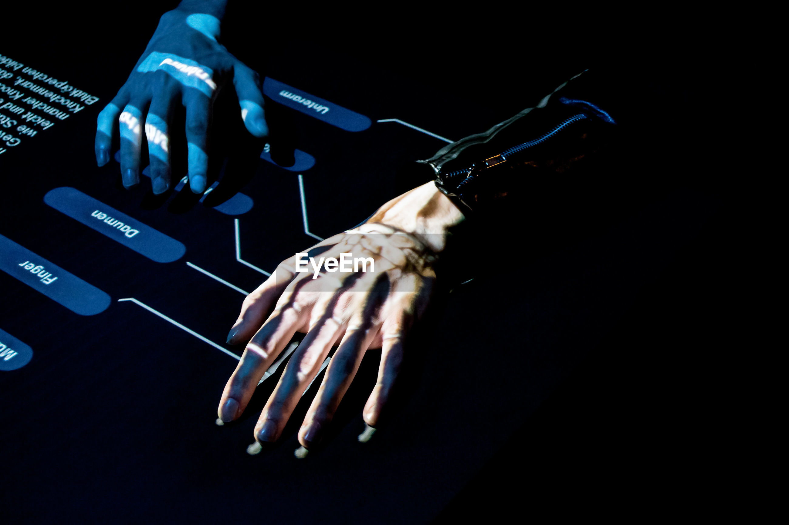 Cropped hands using interface against black background