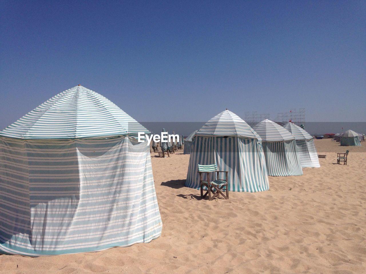 Tents On Beach Against Clear Sky