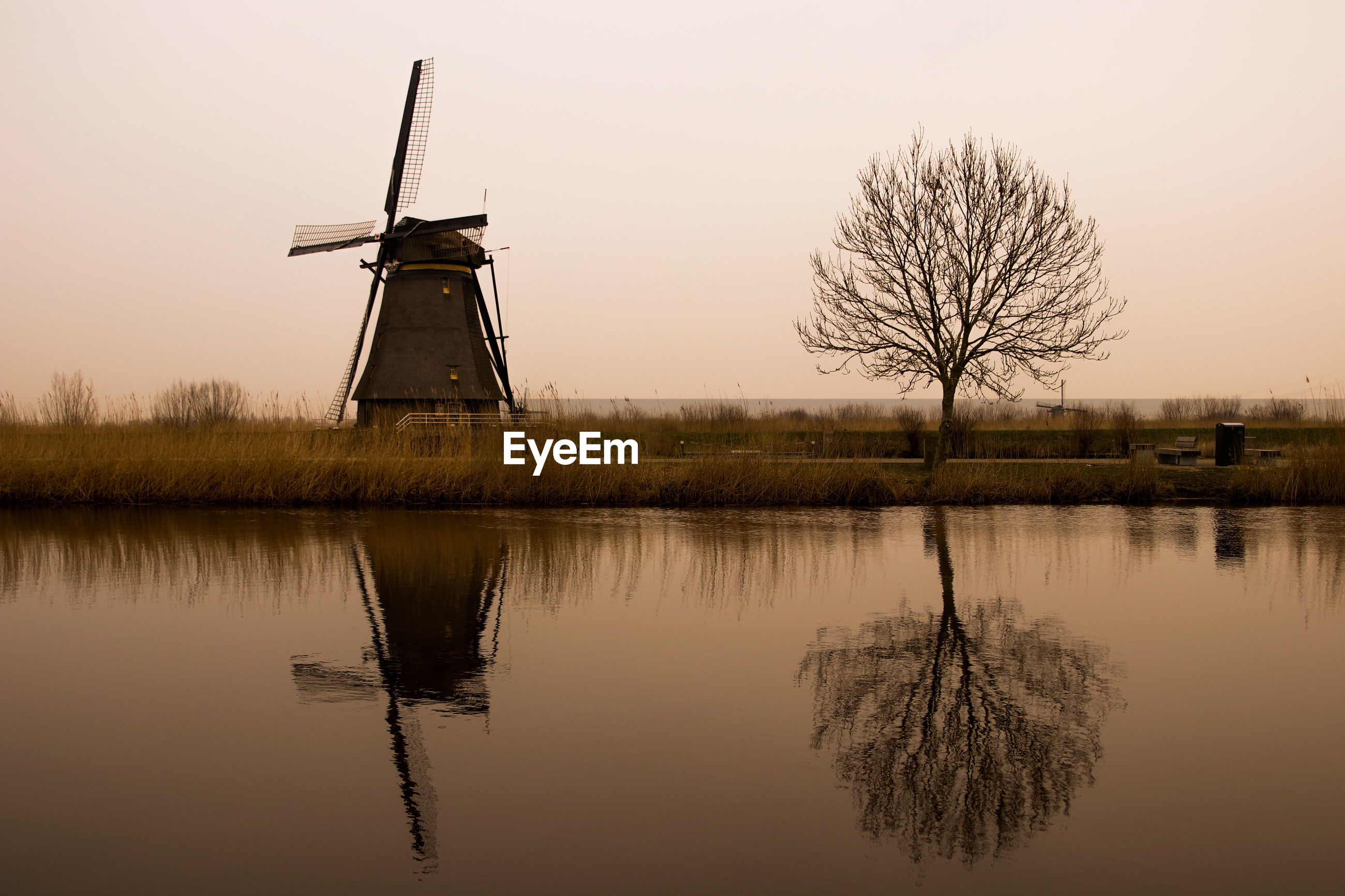 TRADITIONAL WINDMILL BY LAKE