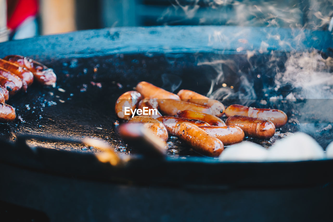 Close-Up Of Sausages On Cooking Pan
