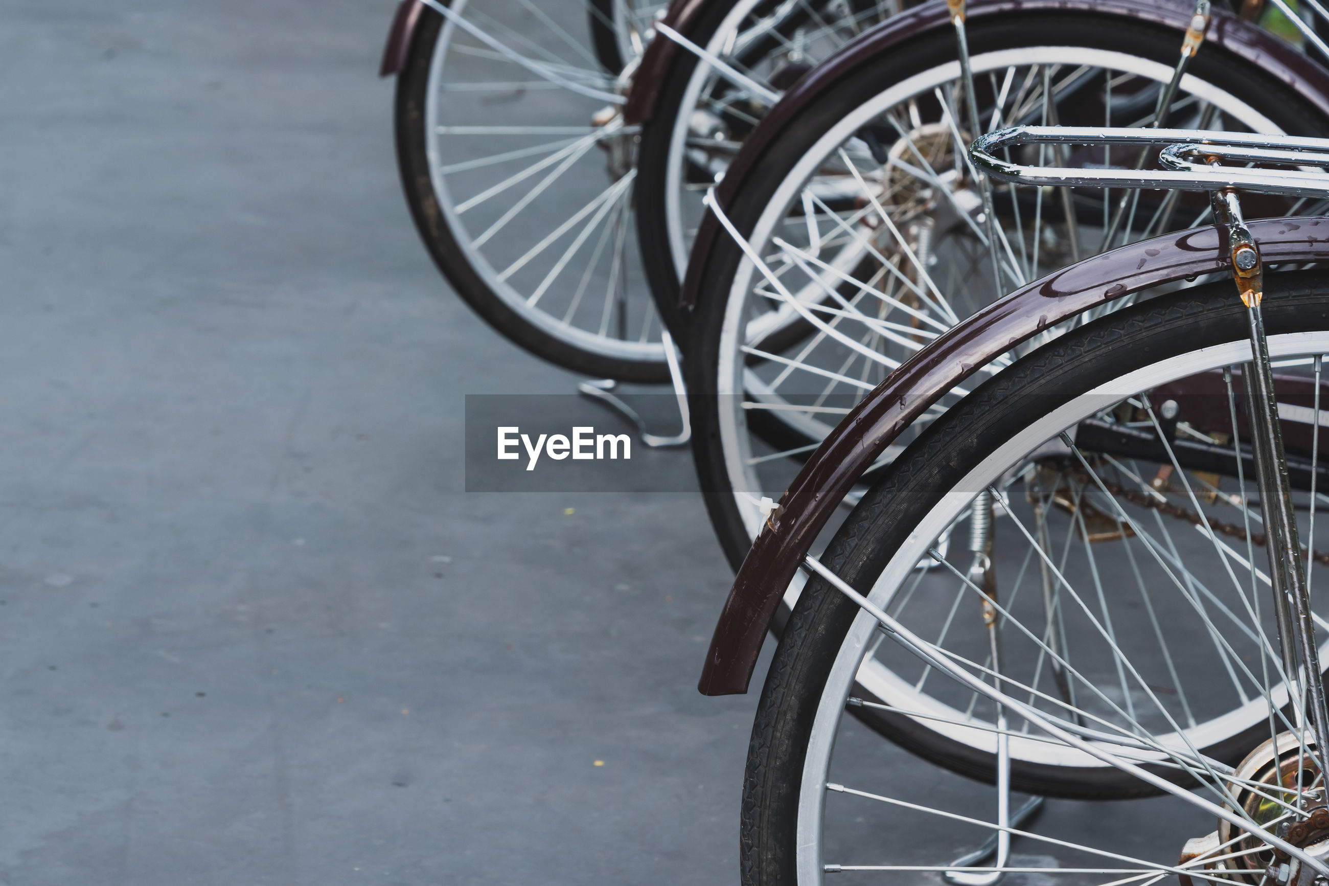 High angle view of bicycle wheels on road