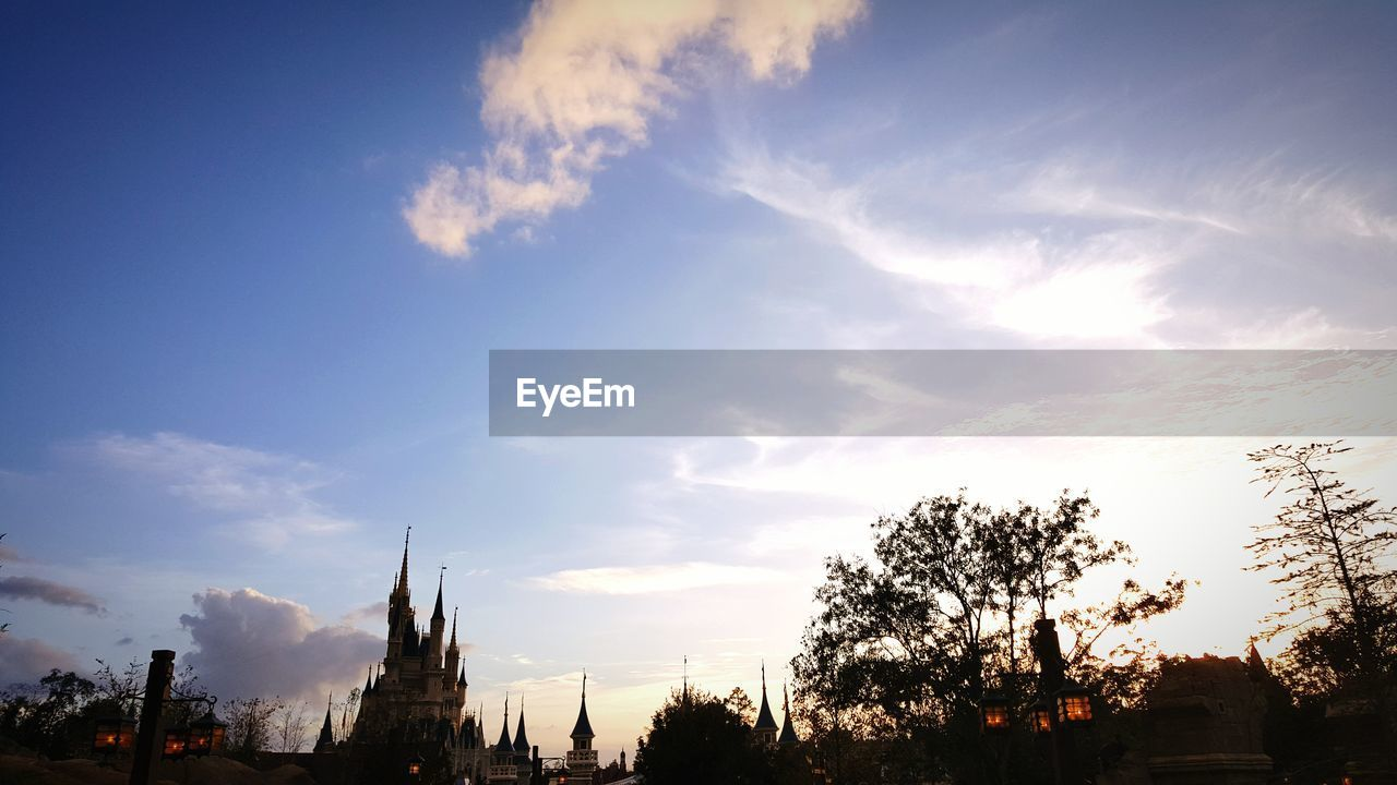 sky, tree, cloud - sky, silhouette, scenics, no people, built structure, low angle view, nature, travel destinations, architecture, beauty in nature, outdoors, sunset, day, city