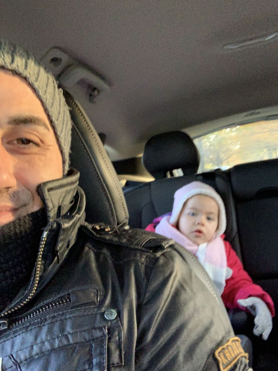 child, childhood, portrait, vehicle interior, mode of transportation, transportation, clothing, two people, males, boys, offspring, family, men, car, emotion, looking at camera, motor vehicle, people, warm clothing, son, daughter, hood - clothing