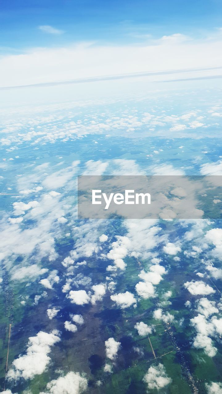 cloud - sky, beauty in nature, scenics - nature, sky, tranquility, tranquil scene, nature, no people, blue, aerial view, day, outdoors, idyllic, white color, environment, water, sea, cloudscape, fluffy, softness, meteorology, view into land