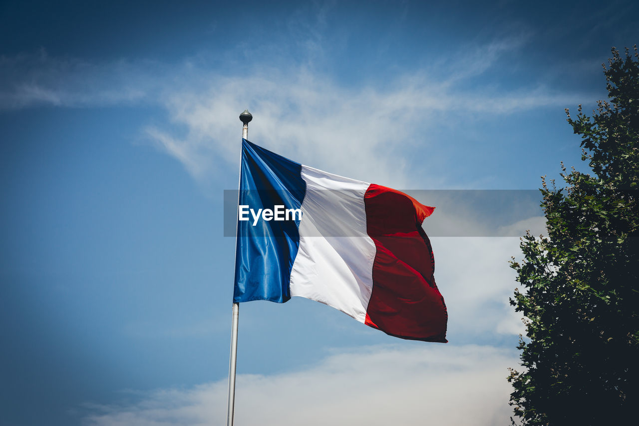Low Angle View Of French Flag Against Sky