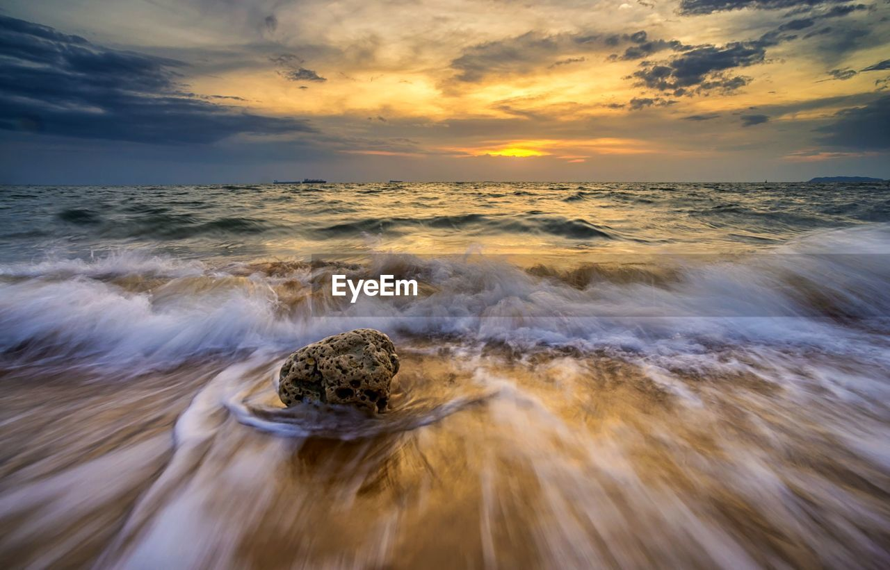 sea, water, sky, motion, sunset, scenics - nature, horizon over water, beauty in nature, cloud - sky, horizon, wave, land, beach, idyllic, no people, long exposure, nature, blurred motion, tranquility, outdoors, flowing water