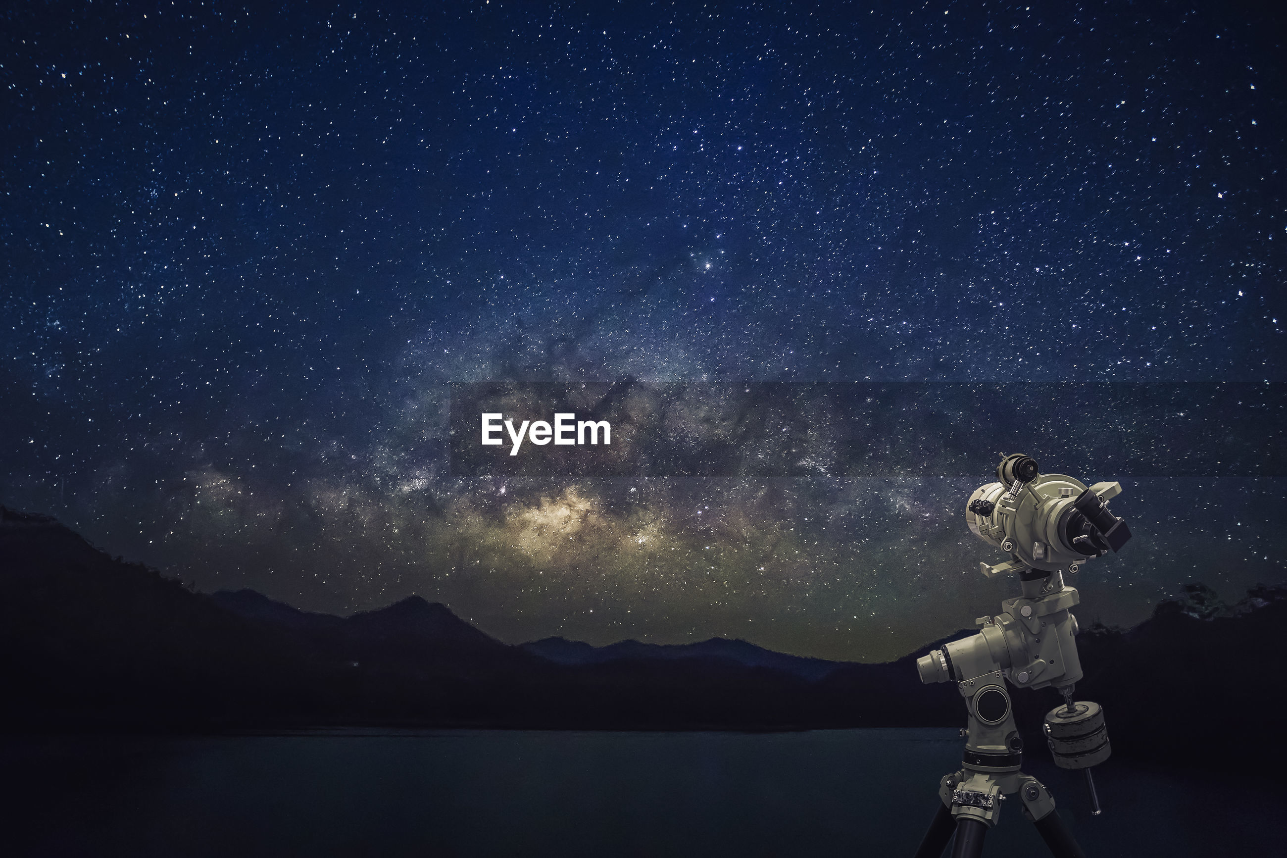 Close-up of binoculars against sky at night