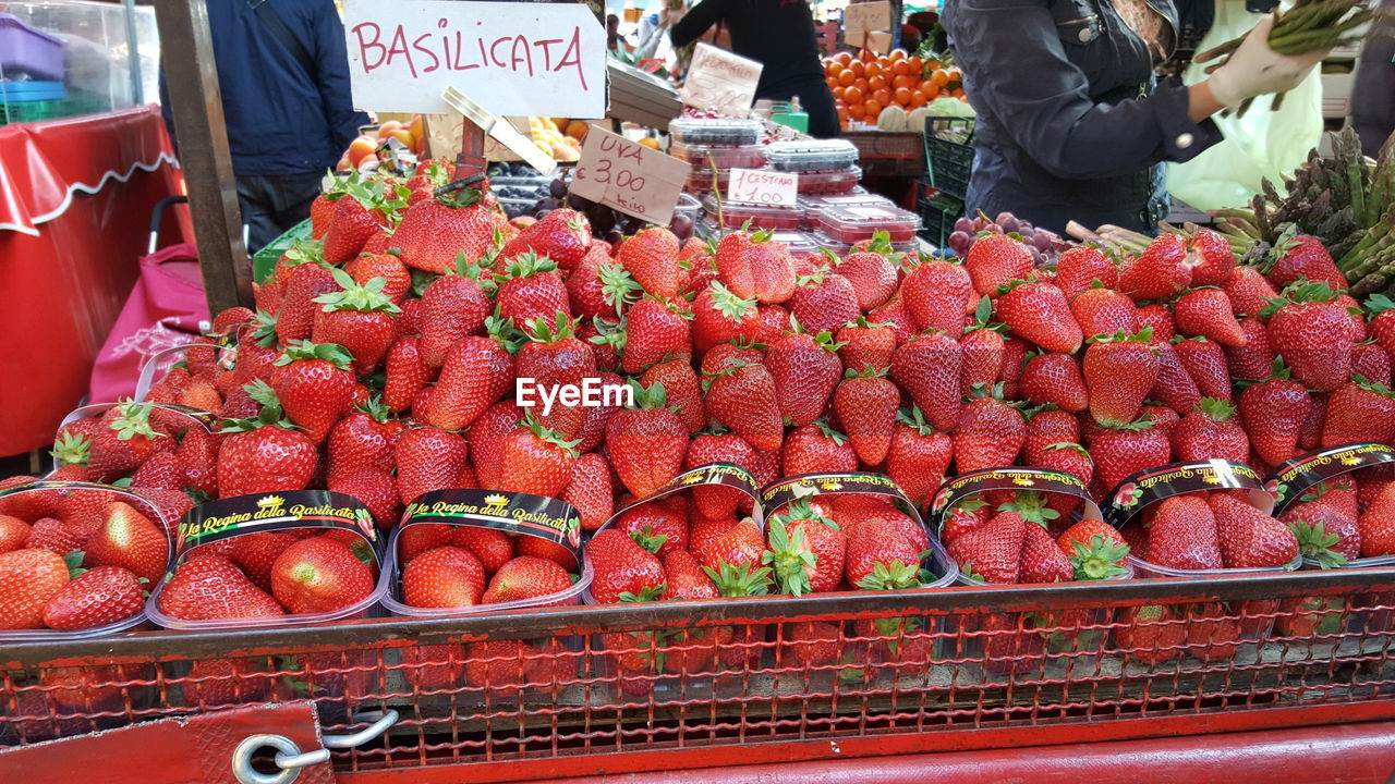 food, retail, food and drink, market, healthy eating, wellbeing, freshness, fruit, for sale, market stall, large group of objects, abundance, red, text, choice, day, arrangement, real people, price tag, business, retail display, sale, outdoors, ripe