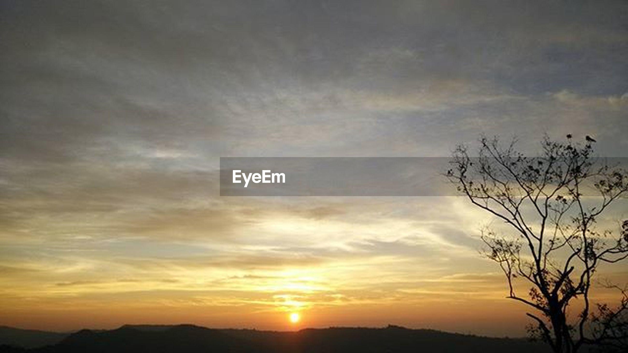 sunset, silhouette, scenics, tranquil scene, sky, tranquility, beauty in nature, orange color, sun, landscape, nature, cloud - sky, idyllic, mountain, cloud, sunlight, dramatic sky, majestic, outdoors, non-urban scene