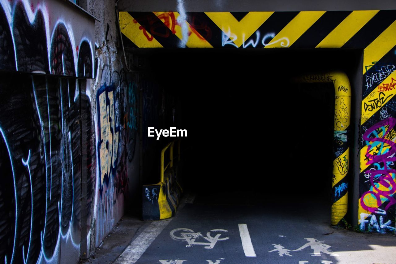 graffiti, creativity, wall - building feature, architecture, art and craft, no people, communication, multi colored, text, street art, sign, indoors, western script, built structure, illuminated, day, symbol, garbage bin, mural