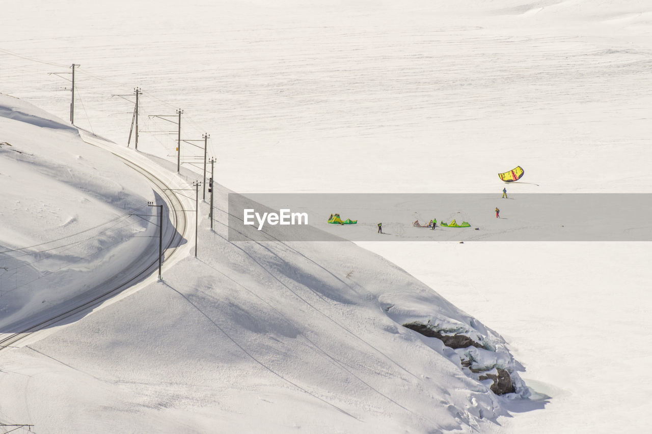 Aerial View Of People On Snow Covered Landscape