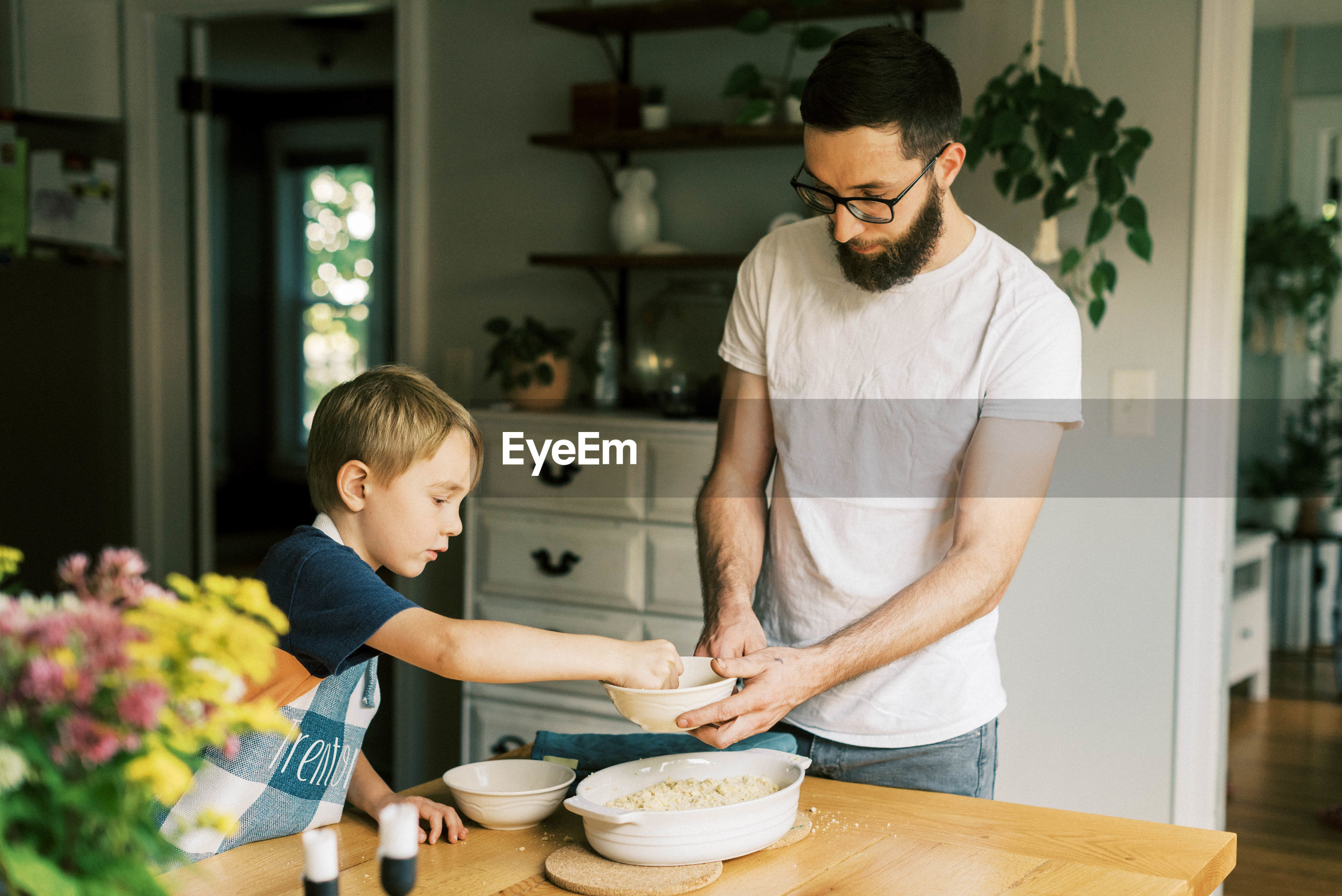 FATHER AND SON STANDING ON TABLE