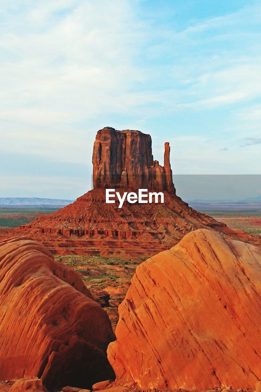 Scenic View Of Rocky Formation At Monument Valley Against Sky