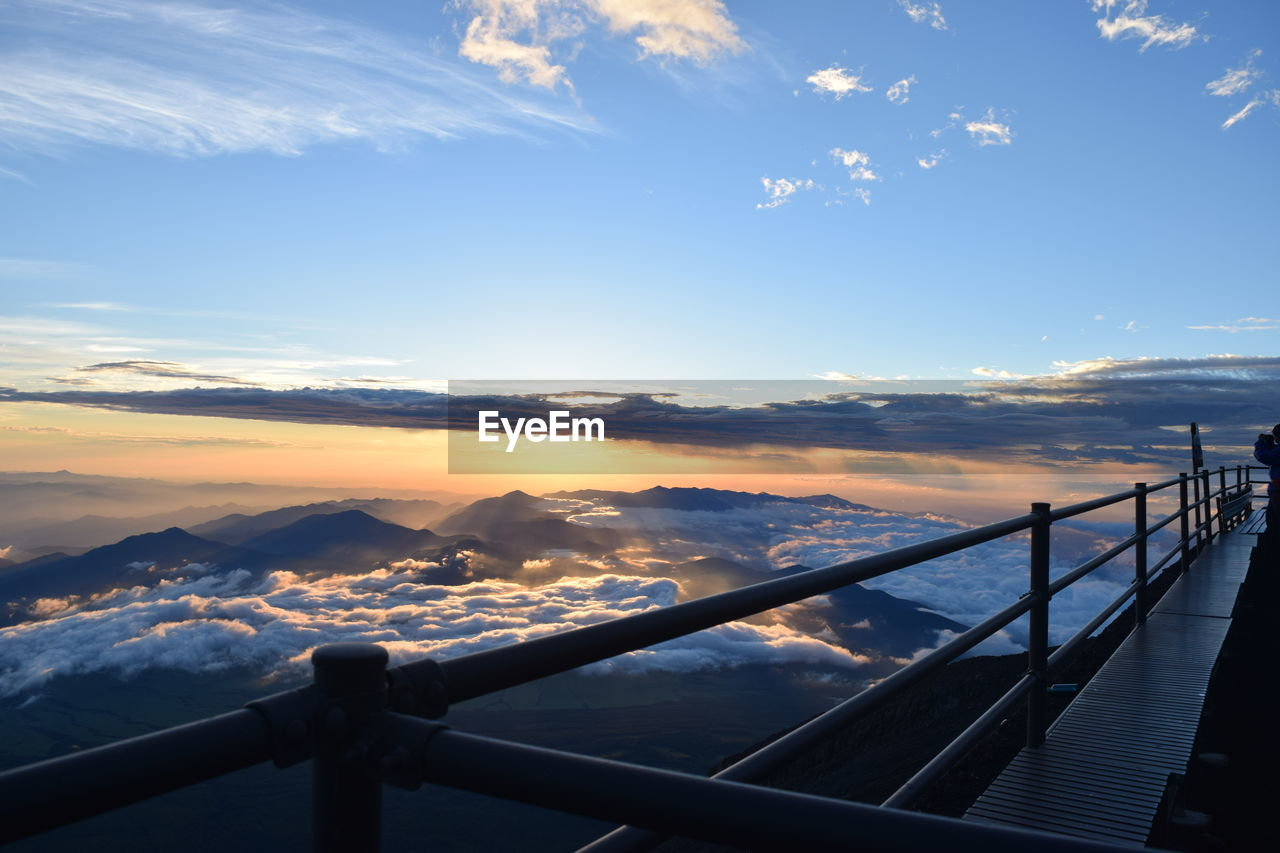 railing, sky, scenics, nature, cloud - sky, beauty in nature, sunset, outdoors, no people, mountain, winter, day, sea, water