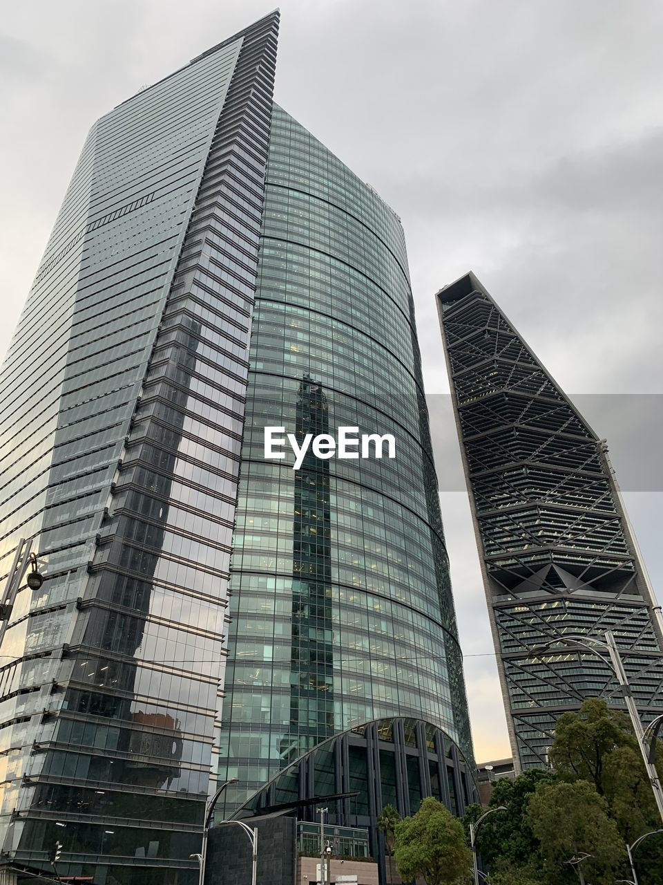 built structure, building exterior, architecture, city, office building exterior, building, modern, office, low angle view, skyscraper, sky, tall - high, tower, day, glass - material, no people, nature, cloud - sky, outdoors, travel destinations, financial district