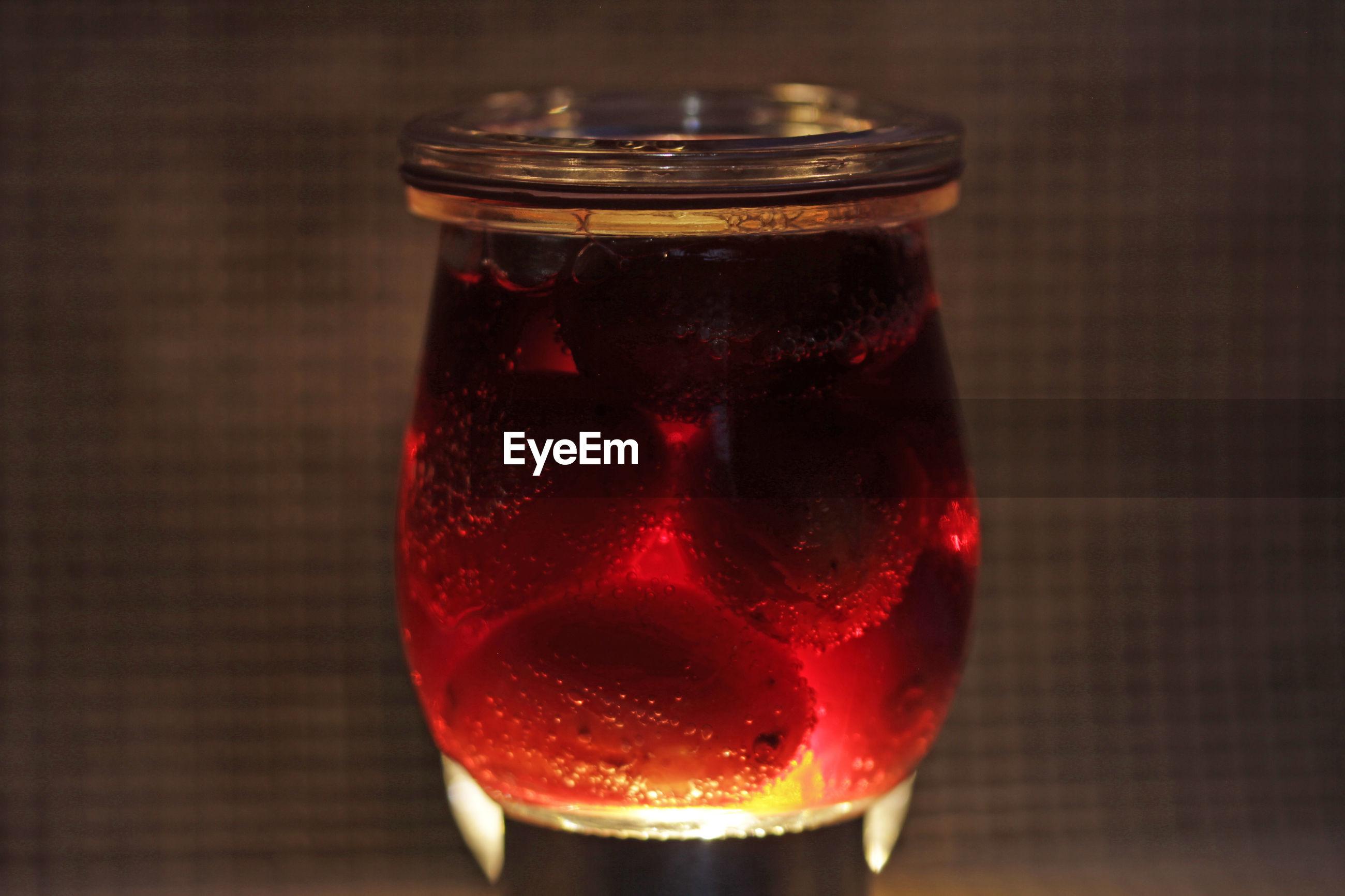 CLOSE-UP OF DRINK IN JAR