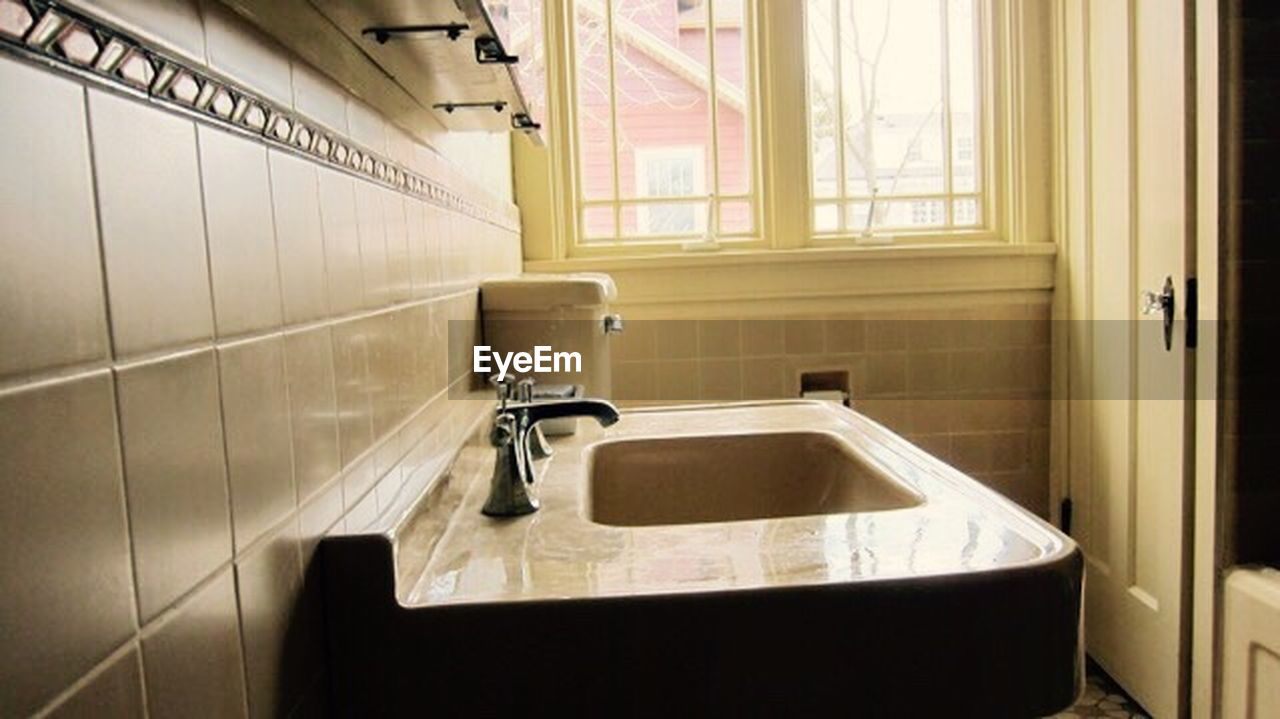 bathroom, sink, household equipment, domestic bathroom, window, indoors, faucet, absence, domestic room, home, no people, flooring, hygiene, home interior, tile, mirror, public building, public restroom, architecture, day, tiled floor, clean, luxury