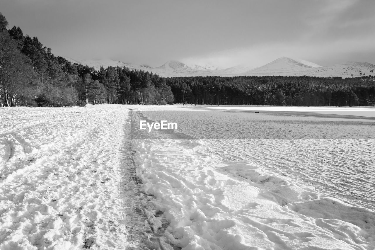 mountain, cold temperature, snow, scenics - nature, sky, environment, winter, tranquil scene, tranquility, beauty in nature, landscape, no people, nature, day, land, non-urban scene, mountain range, field, covering, snowcapped mountain