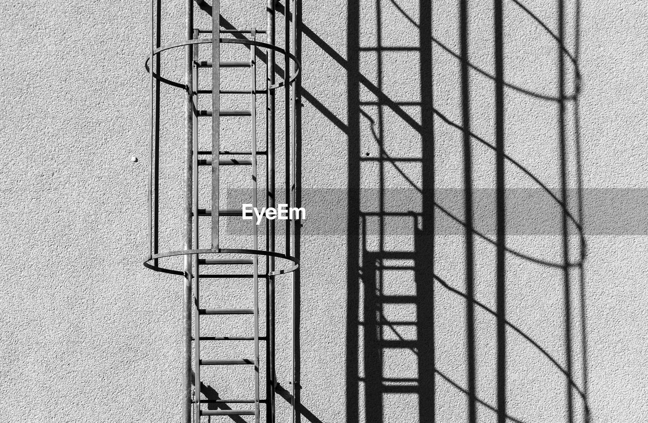 Low Angle View Of Ladder Against Wall