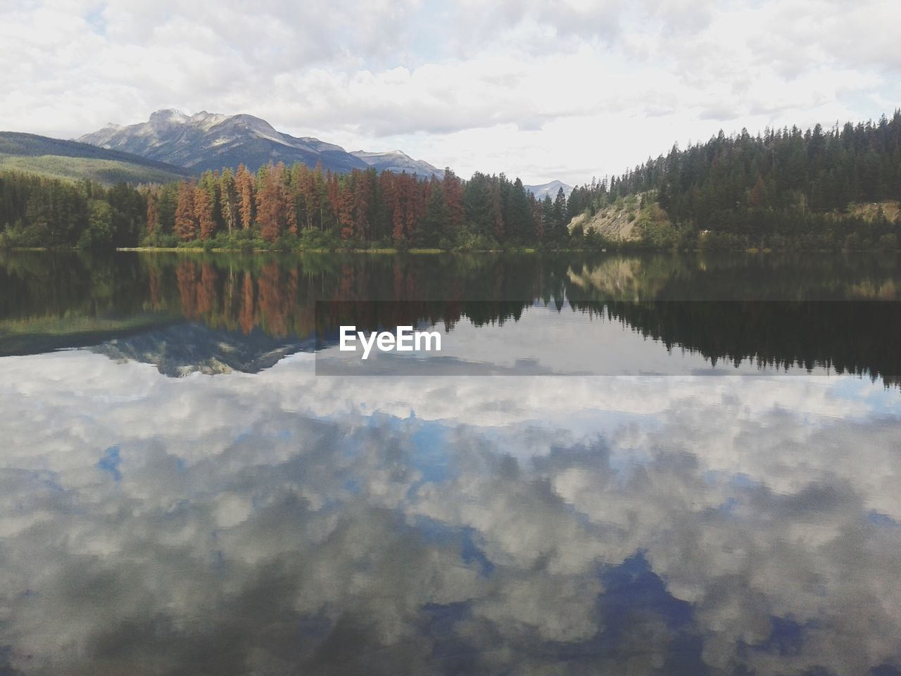 reflection, cloud - sky, water, sky, lake, tranquility, beauty in nature, tranquil scene, scenics - nature, mountain, waterfront, day, tree, nature, idyllic, non-urban scene, plant, no people, symmetry, outdoors, reflection lake