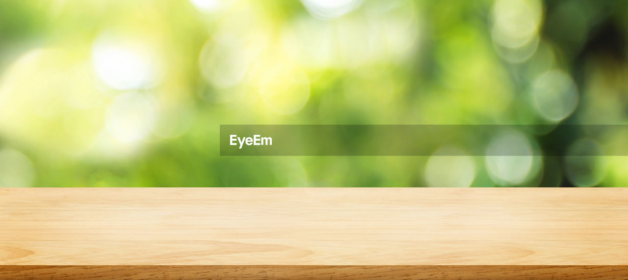 wood - material, focus on foreground, table, no people, close-up, day, wood, green color, outdoors, pattern, tree, plant, selective focus, brown, nature, textured, plank, still life, flooring, wood grain