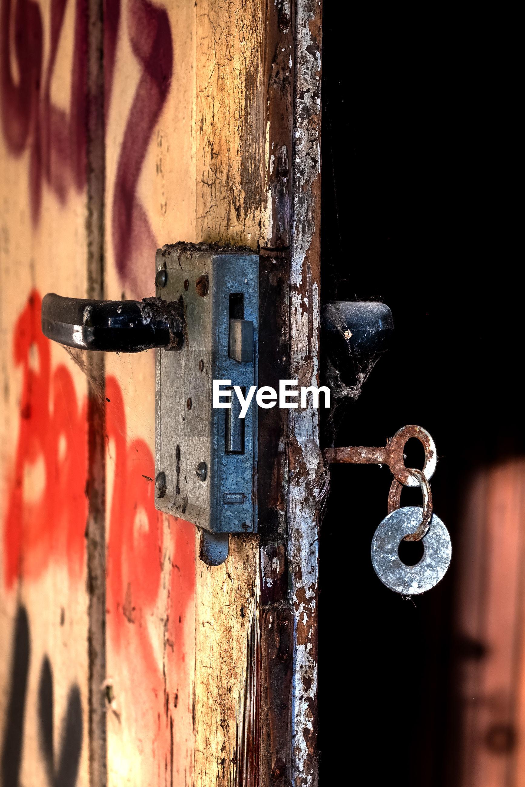 Weathered door with rusty key