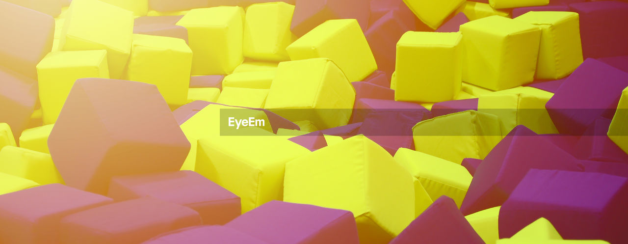 indoors, full frame, multi colored, no people, large group of objects, backgrounds, close-up, yellow, still life, stack, abundance, paper, cube shape, choice, high angle view, pattern, heap, variation, shape, art and craft, chopped, excess