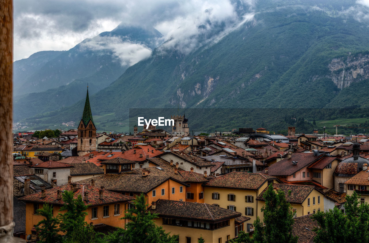 mountain, architecture, building, building exterior, built structure, city, roof, residential district, town, no people, nature, house, mountain range, tree, scenics - nature, day, outdoors, high angle view, location, sky, townscape, place, range
