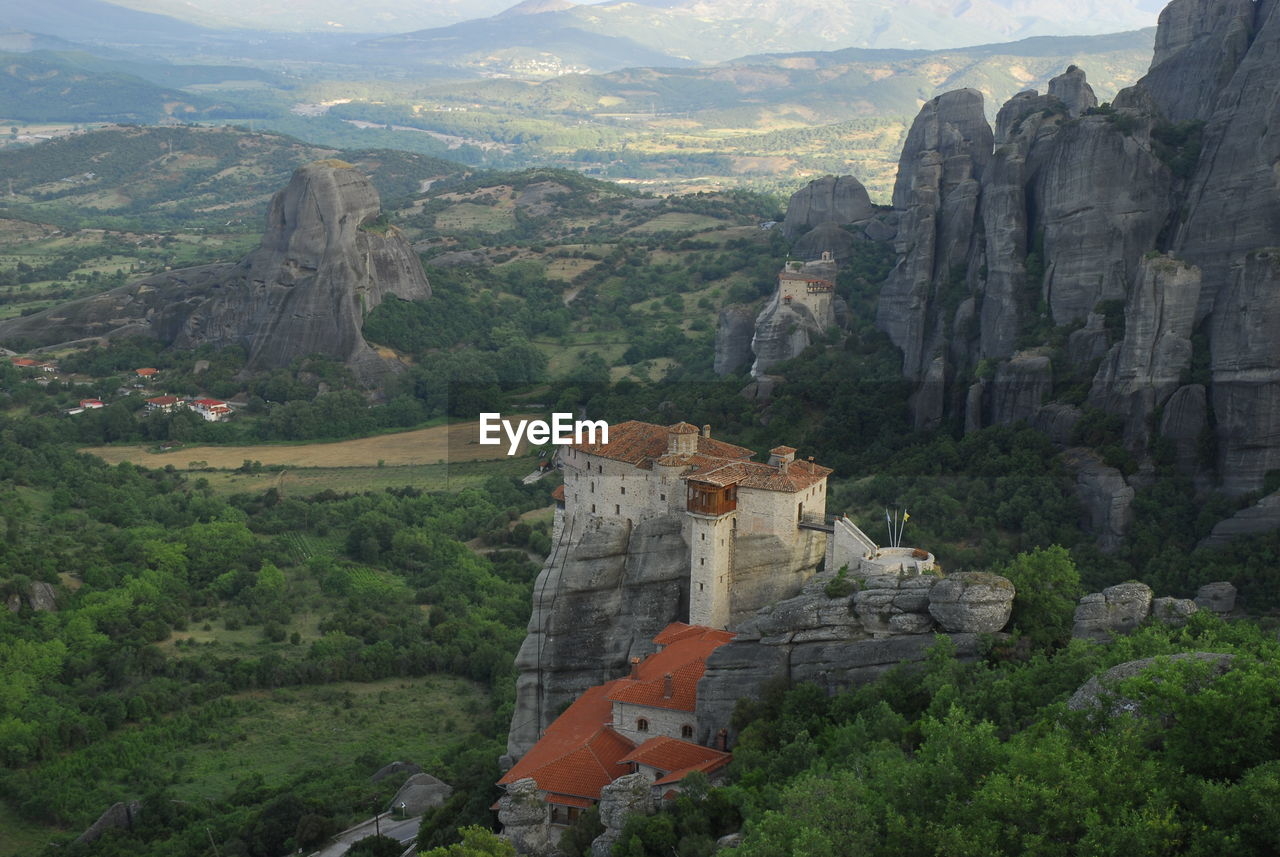 HIGH ANGLE VIEW OF BUILDINGS AND MOUNTAIN