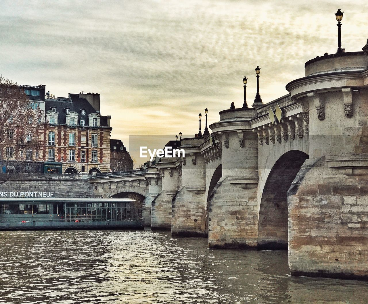 architecture, built structure, building exterior, water, sky, river, cloud - sky, waterfront, bridge - man made structure, connection, outdoors, no people, day, travel destinations, sunset, city, nature